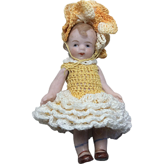"""3"""" antique German all Bisque Mibs doll by Louis Amberg and Sons."""