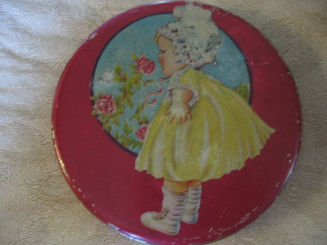 Vintage Tin Adorable Early 1900s Baby Girl Smelling the Roses