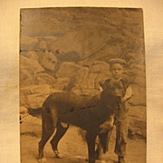 Early 1900s RPPC Young Boy with Huge Black Dog Bull Mastiff Lab??
