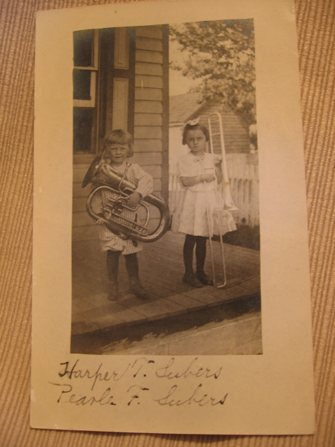 Early 1900s RPPC Boy with Tuba Girl with Trombone