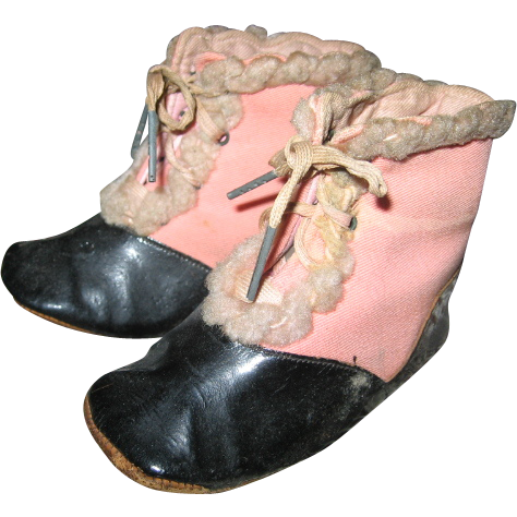 antique pink black two toned baby shoes with trim from