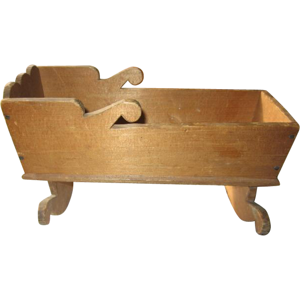 Homemade Wooden Doll Cradle with Ornate Scroll Design