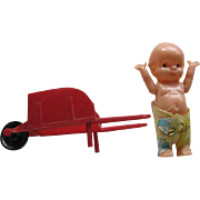 Vintage Kewpie Doll with Red Wheelbarrow