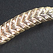 Goldtone Feather Brooch with Rhinestones