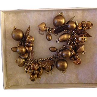 Vintage fun bracelet with hearts, baubles , leaves and balls