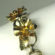 Coro Gold Tone Metal and Amber Rhinestone Floral Bracelet