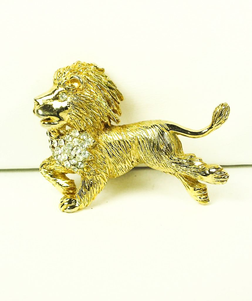 Hattie Carnegie Rhinestone and Gold Plated Metal Running Lion Pin