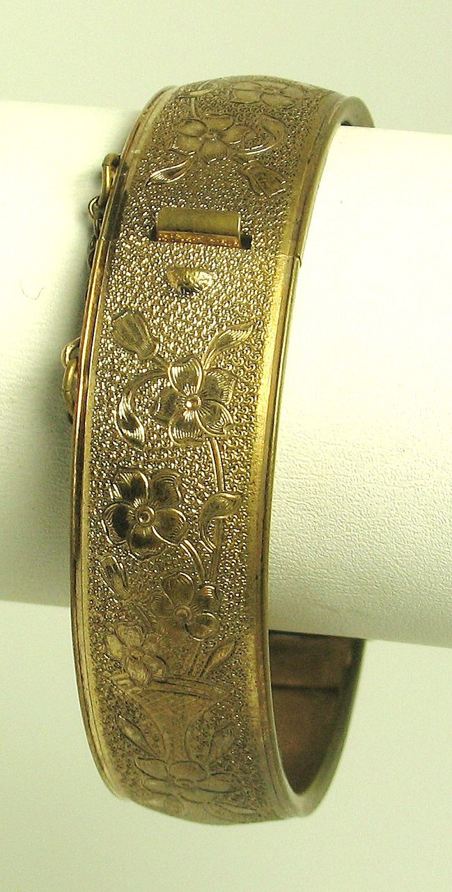 Hinged Carved Gold Tone Metal Floral Bracelet