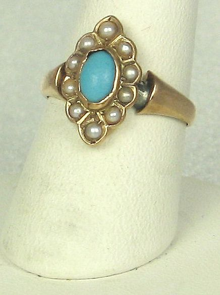 Item ID: 2487- Turquoise Gold Ring In Shop Backroom