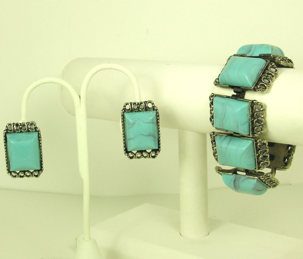 Turquoise Colored Plastic and Metal Bracelet and Earrings