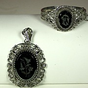 Whiting and Davis Black Glass Intaglio Floral Pendant and Bracelet