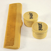 Pair of French covered salve/rouge pots and celluloid comb