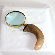 Vintage gold metal and horn magnifying glass