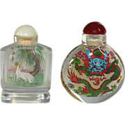 Pair of Chinese Glass reverse painted snuff bottles