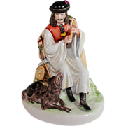 Zsolnay Hand Painted Figurine of a Seated Flute Player and his Dog, Signed