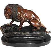 Large Bronze Sculpture of a Lion with a Boar