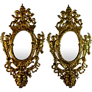 Pair of Antique French Gilt Bronze Mirrors with Putti and Grotesque