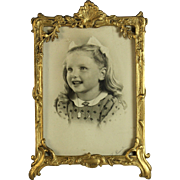 French Gilded Photo Frame with Photo of a Young Girl early 20th C