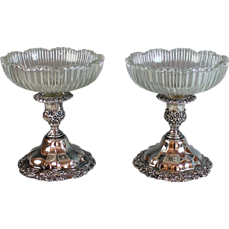 Pair of Silverplate Substantial Candle holders with Glass Inserts