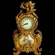 Antique Gilt Bronze New Haven Clock Co. Porcelain-Faced Mantle Clock with Cherub