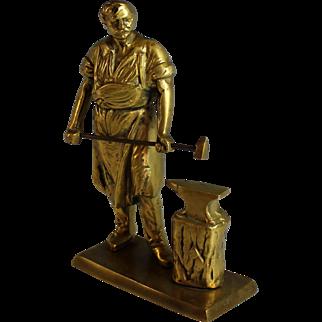 Vintage Bronze Sculpture of a Muscular Blacksmith