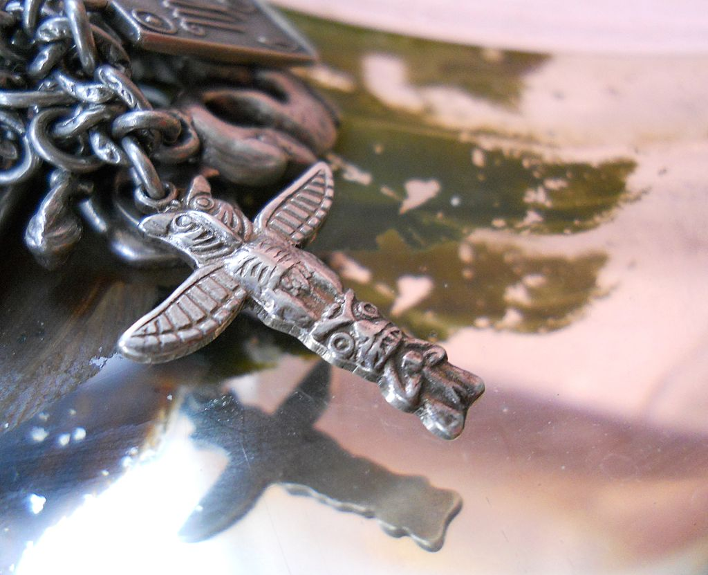 Vintage Sterling Silver repousse Totem pole Charm