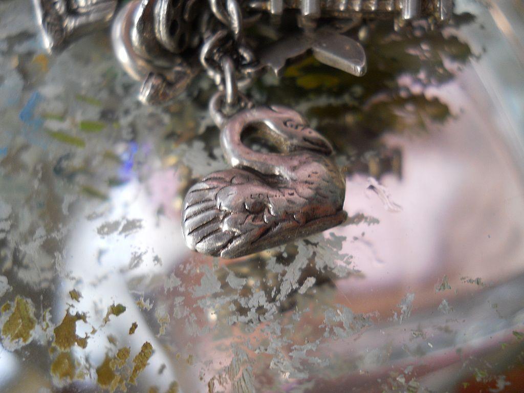 Antique repousse Silver Swan Charm
