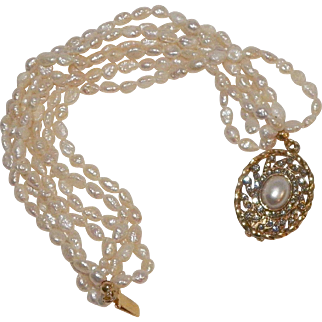 Multi-Strand Rice Pearl Bracelet With Pearl and Rhinestone Clasp