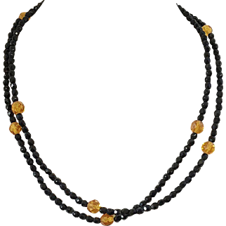 Single Strand Beaded Black and Amber Colored Necklace