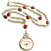Lover's Eye Necklace - 9 karat Gold Cultured Pearl Mourning Locket Cultured Seed Pearl Hessonite Garnet Necklace
