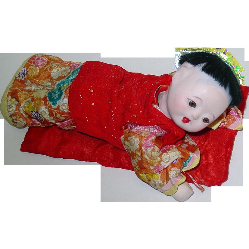 Vintage 7 1/2 inch Gofun Ichimatsu Japanese Baby Boy Laying Down