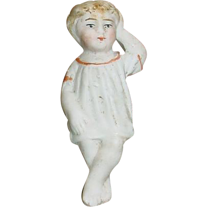 "Tiny 2 1/2"" Antique Reclining All Bisque German Child"