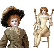 "18"" French Fashion Doll With Cobalt Eyes, Kid Over Wood Body and Full C. 1873 Trousseau with Four Ensembles!"