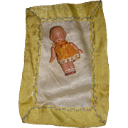 Vintage Miniature Celluloid Doll with Silk Coverlet