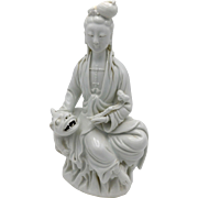 White Chinese Porcelain figure of Guanyin with Buddhist Lion