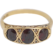 Lovely 18kt Gold, Garnet and Diamond Ring
