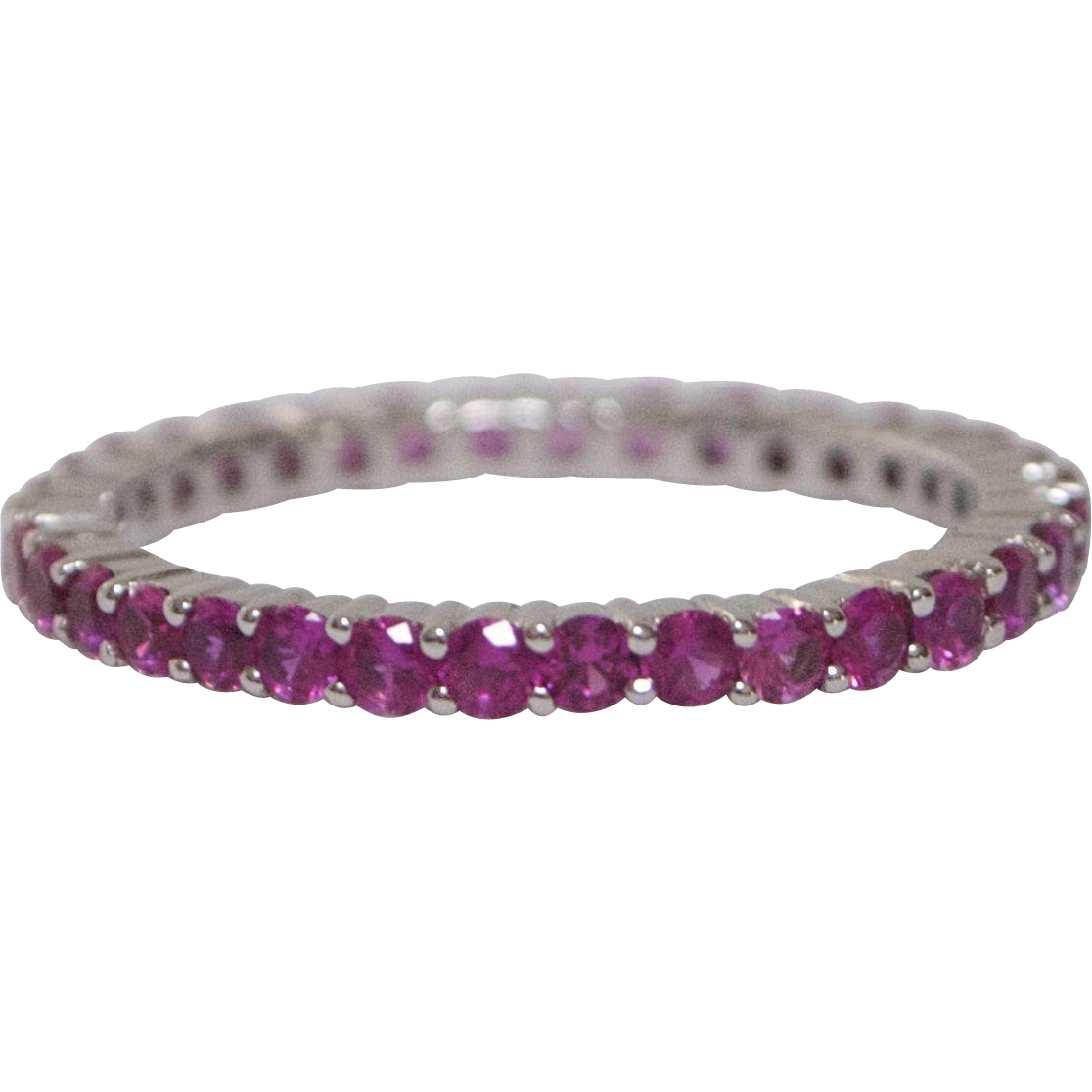 18kt white gold and pink sapphire eternity band from