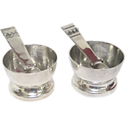A Pair of Sterling Silver William Spratling Salt Cellars with Spoons