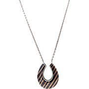 Early 20th Century Sterling Silver and Rose Gold Horseshoe Necklace