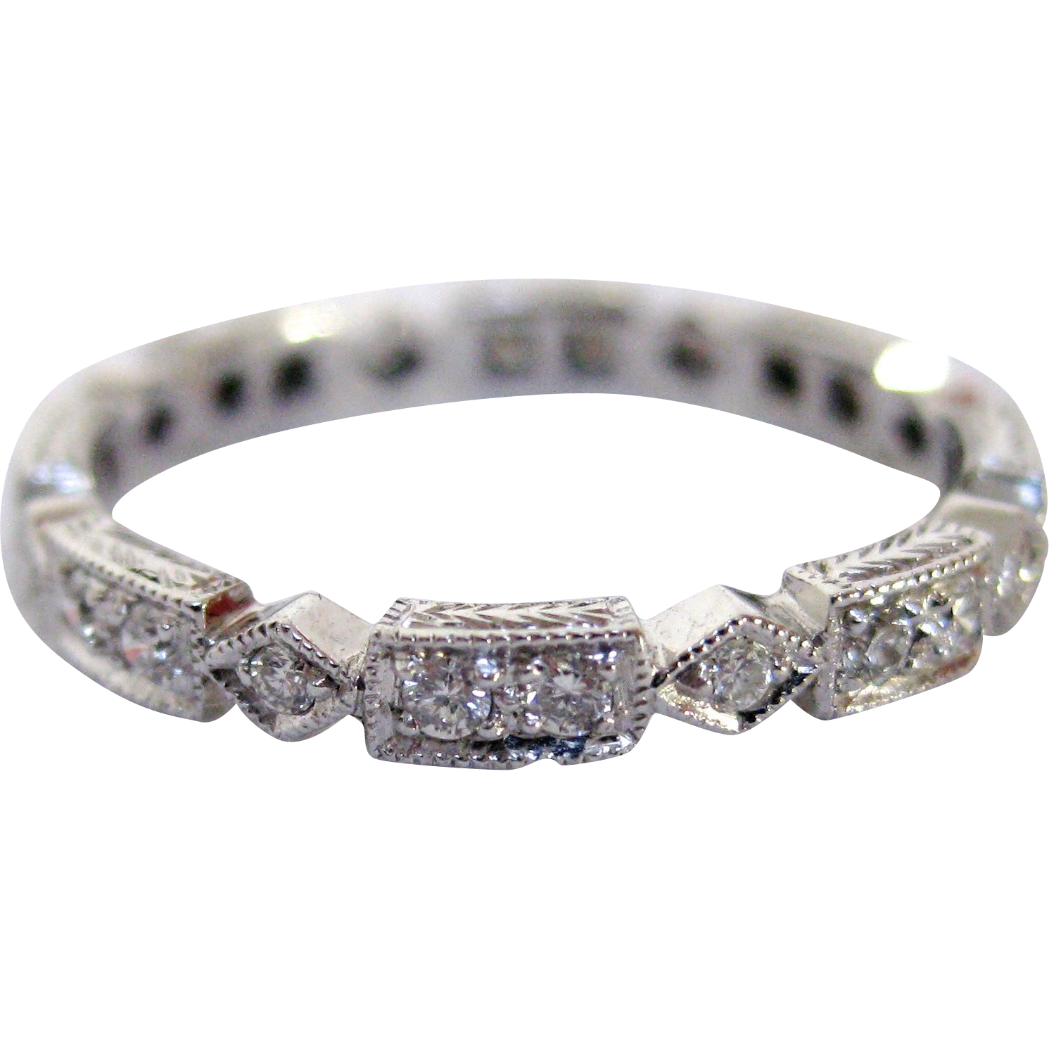 18 karat white gold and eternity ring from