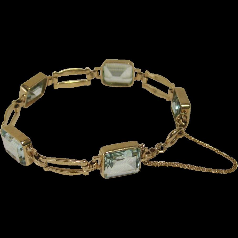 emerald cut aquamarine bracelet in 14k yellow gold from