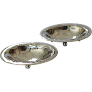 A Pair of Georg Jensen Hand Hammered Footed Salt Dishes