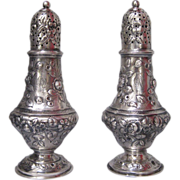 Pair of Tiffany Sterling Silver Repousse Muffineers/Sugar Casters/Salt and Pepper Shakers, circa 1890s