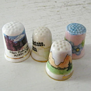 Four Fine China Souvenir Thimbles