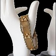 Gold tone Mesh and Faux Pearl Floral Motif bracelet