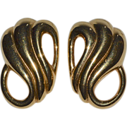 Monet ~ Large Polished Goldtone Swirled Clip Earrings