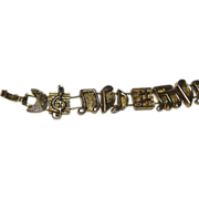 1995 TOFA Double Slider Music Note Goldtone Bracelet