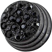 Early 20th c Raised Plastic Button with Several Black Glass Jewels Attached.