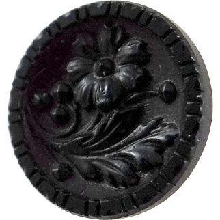 Victorian black glass button with metal shank and detailed floral decoration
