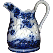 Swedish Flow Blue Pitcher, Pure White with Embossed Cherubs - Red Tag Sale Item